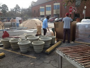 Bert and Ben unpacking beautiful cast stone planters.,,
