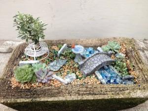 Miniature garden w/ var. euonymous std, stone bridge, b/bath w/ cardinal