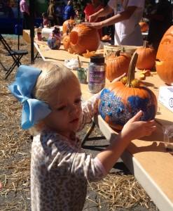 Her bow matches her pumpkin!