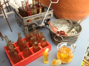 Miniature garden asst stuff, coke bottles in crate, tub w/ ice, iced tea set