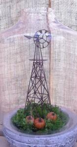 A pumpkin patch under a windmill...