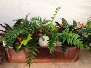 A copper planter for a table. Jamie's colorful fall design of chartreuse, orange and white...