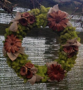 A reindeer moss wreath, with burlap and pods...